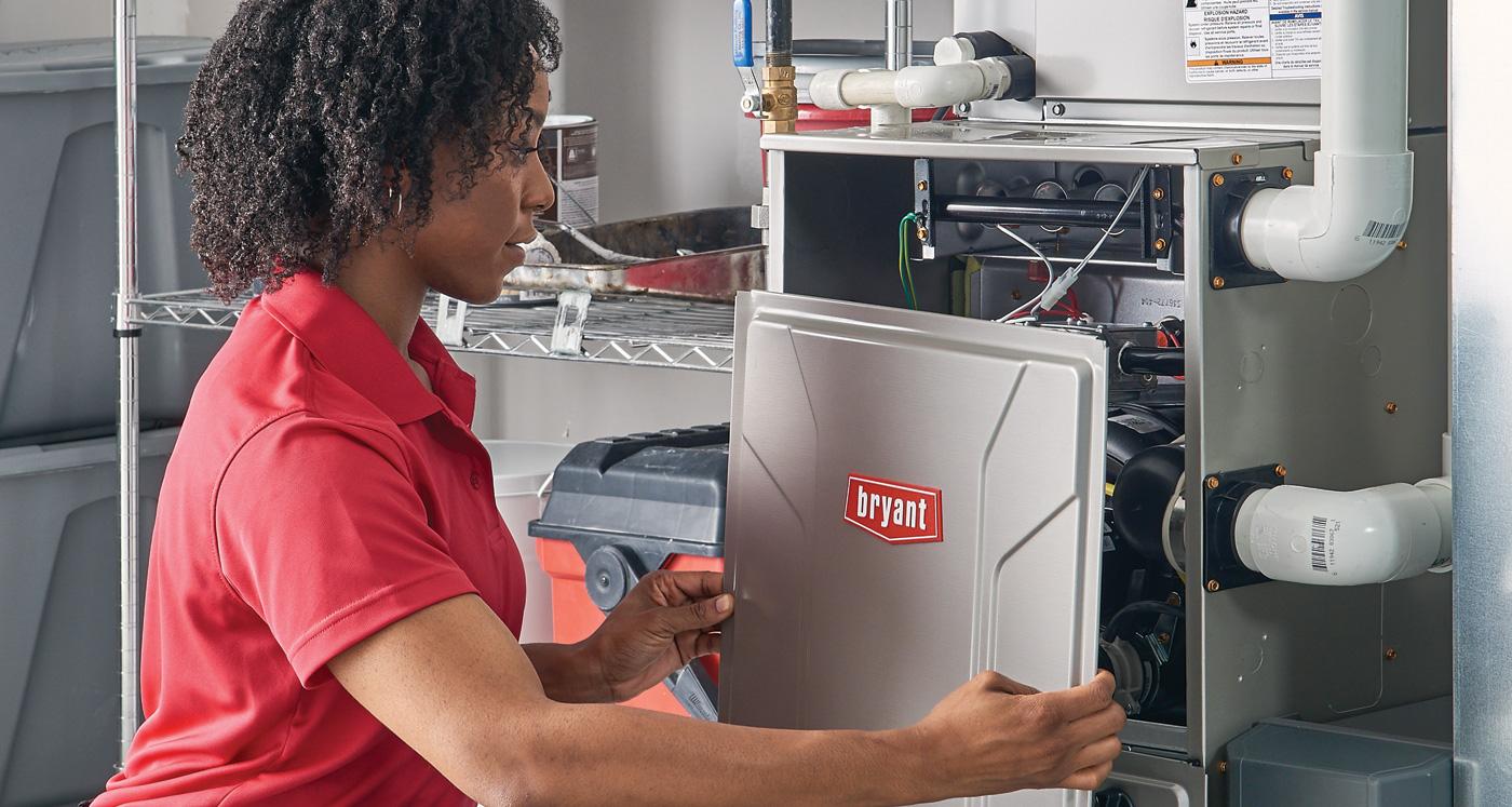 Technician installing a furnace