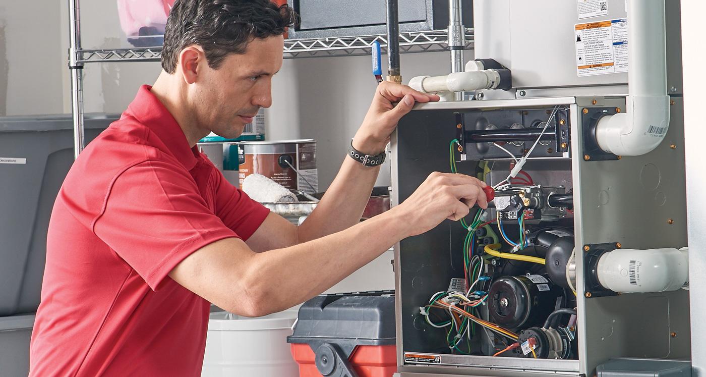 Technician repairing a furnace